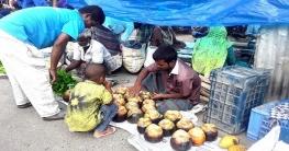 দুপচাঁচিয়ায় হাট বাজারে পাকা তালের সমারোহ